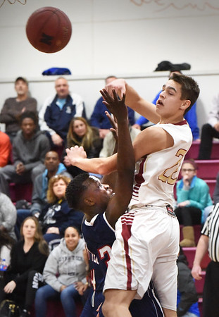 BRYAN EATON/Staff photo. Newburyport's Casey McLaren passes to an open teammate.