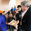 BRYAN EATON/Staff photo. Nyati Misra, 11, left, and Alexandra Yavarow, 8, both of Newburyport receive certificates for visiting the Custom House Maritime Museum from George Washington, a.k.a volunteer Paul Armstrong, and Richard Alfoni who was playing a wharf worker.