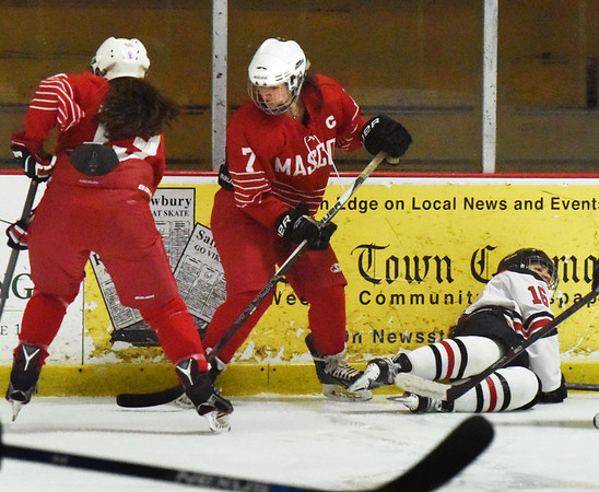 BRYAN EATON/Staff photo. Lexi Rosenbaum, left, and Isabelle Sarra go for a loose puck.