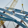 BRYAN EATON/Staff photo. Riveters were on the two new arches of the southbound span of the new Whitter Bridge on Interstate 95 on Tuesday afternoon. The project is expected to be completed in late summer or early fall.