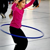 BRYAN EATON/Staff photo. Maggie Himmel, 7, gets some practice with a hula hoop in Margaret Welch's physical education class on Thursday afternoon. She and her fellow second-graders will be going out on snowshoes on Friday afternoon.
