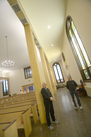 JIM VAIKNORAS/Staff photo Church members Jim Robinson, and Stuart Johnson talk about resent renovations to the Central Congregational Church in Newburyport Monday.