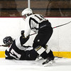JIM VAIKNORAS/Staff photo HPHA's Mikayla Sargent collides with a Lynnfield player at Veteran's Rink in Haverhill.