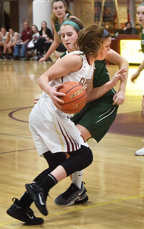 BRYAN EATON/Staff photo. Newburyport's Krysta Padellaro pushes her way past Pentucket's Jess Galvin.