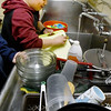 BRYAN EATON/Staff photo.  Omar Mahmood, 13, volunteered to the clean the dishes in the kitchen at the Newburyport Rec Center. He was part of the group making quesadillas in the kitchen of the old Brown School, now the headquarters of Newburyport Youth Services.