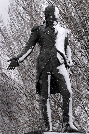 BRYAN EATON/Staff photo. Tuesday's heavy wet snow gives the statue of George Washington at Bartlet Mall in Newburyport a sticky coating. The temperature for Wednesday is in the 50's with more snow forecast for Thursday.