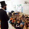 BRYAN EATON/Staff photo. With Presidents' Day on Monday, the 16th one made a visit to first-graders at the Bresnahan School on Friday. Abe Lincoln, a.k.a. Gus Harrington, husband of teacher Sue Harrington, told the children of his life from rail splitter, lawyer then being president and ending slavery.