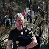 JIM VAIKNORAS/Staff photo Hamish Blackman of Natick takes advantage of the warm weather to play bagpipes along the boardwalk on the Newburyport waterfront Saturday. His music could be heard through out downtown.