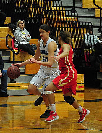 JIM VAIKNORAS/Staff photo Triton's Tessa Lafrance drives to the basket against Everett Wednesday night at Triton.