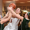 BRYAN EATON/Staff photo. Newburyport's Olivia Olson gets coverage from Pentucket defenders.