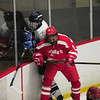 JIM VAIKNORAS/Staff photo Triton's Josh D'Arcy is checked by St John's Matthew Mattero during their game at the Graf Rink in Newburyport Monday night.