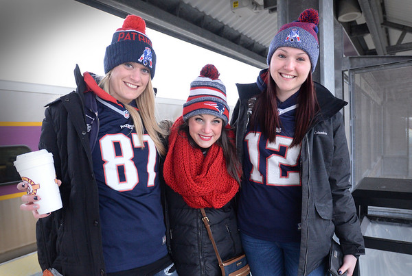 BRYAN EATON/Staff photo. Waiting for some more friends arrive, Patriot's fans Dawn Storck, Amesbury; Jessica Karamourtopoulos, Amesbury and Kate Murdock of Danville, N.H. get ready to board the train at the Newburyport station.