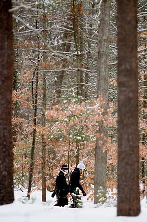 JIM VAIKNORAS/Staff photo Two women take a walk through a snowy Maudslay State Park in Newburyport Sunday morning.
