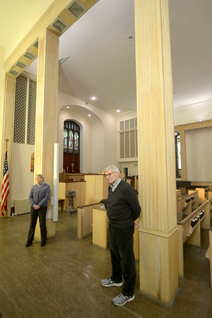 JIM VAIKNORAS/Staff photo Church members Amantha Moore and Jim Robinson talk about resent renovations to the Central Congregational Church in Newburyport Monday.