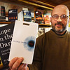 "BRYAN EATON/Staff photo. Jabberwocky Book Shops' Paul Abruzzi with ""Hope in the Dark"" by Rebecca Solmit and George Orwell's ""1984."""