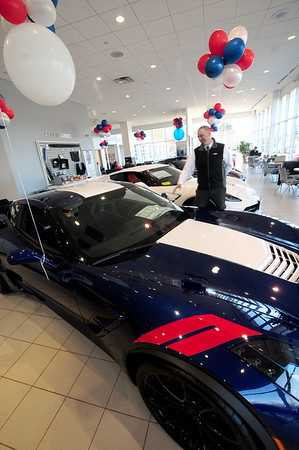 JIM VAIKNORAS/Staff photo Salesman Kelcey Przybyla goes over the features of a Corvette in the show room at Amesbury Chevrolet Monday afternoon.