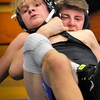 BRYAN EATON/Staff photo. Triton wrestler Anthony Ostrander gets Marblehead/Swampscott's Dakota Pilicy around the neck and won the match.