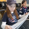 JIM VAIKNORAS/Staff photo Sofia Lusard and Sonia Tummala, students in Joan Sheehan's 3rd grade class at the Bresnahan School in Newburyport shows their Patriot's pride as they work on poetry Friday  Many of their classmates  also dressed in support of the home town team.