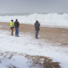 BRYAN EATON/Staff photo. Television crews and the curious were at Plum Island checking out the surf just before high tide on Monday afternoon, but the waves never made that far up the beach as in other, more severe storms.
