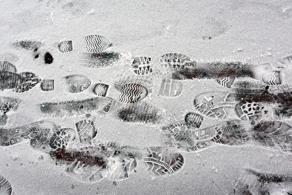 BRYAN EATON/Staff photo. Footprints in the snow along the sidewalk on Harris Street in Newburyport create a wintry still life on Thursday morning.