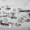 BRYAN EATON/Staff photo. Footprints in the snow along the sidewalk on Harris Street in Newburyport create a wintry still life on Thursday morning.
