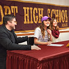 BRYAN EATON/Staff photo. Maddie Green, flanked by her parents, Mike and Elise, signs a letter of intent for St. Michael's College.