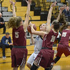 JIM VAIKNORAS/Staff photo Triton's Melanie Primpas drives on Newburyport's #5 Olivia Olson and #10 Paige Gouldthorpe during their game at Triton Friday night.