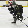 JIM VAIKNORAS/Staff photo Pentucket's Josh Smith  advances the puck against Lynn at the Graf Rink in Newburyport Wednesday night.