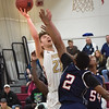 BRYAN EATON/Staff photo. Newburyport Brendan Powers is fouled by Lynn Tech.