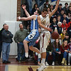 JIM VAIKNORAS/Staff photo  Triton's Liam Spillane and Newburyport's casey McLaren try to save the ball from going out of bounds during their game at Newburyport Friday night.