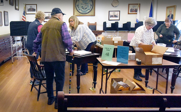 """BRYAN EATON/Staff Photo. People check in for early voting in Newburyport City Hall's council room late Monday morning for the state primary next Tuesday, part of """"Super Tuesday."""""""