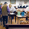 "BRYAN EATON/Staff Photo. People check in for early voting in Newburyport City Hall's council room late Monday morning for the state primary next Tuesday, part of ""Super Tuesday."""