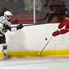 BRYAN EATON/Staff photo. HPNA's Morgan Whitlock shoots past a Hingham defender.