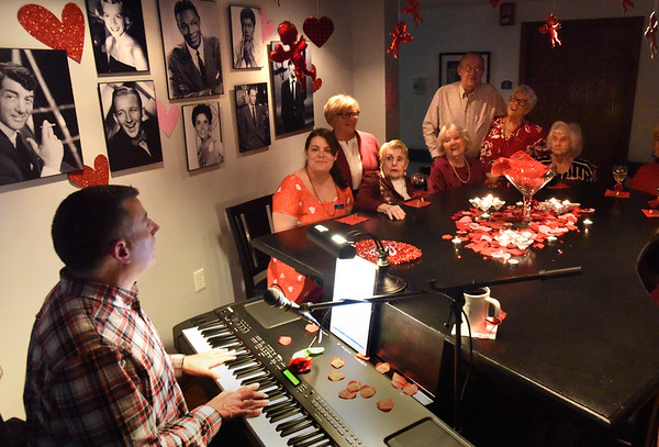 BRYAN EATON/Staff Photo. Robert Dionne leads residents of the Salisbury Assisted Living Center at the Cabaret Lounge in a series of love songs on Monday. The event was the kickoff for several Valentine-themed for their Love Week.