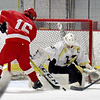 BRYAN EATON/Staff photo. Haverhill goalie stops a shot by Amesbury #16.