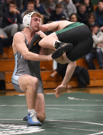 BRYAN EATON/Staff photo. Ethan Trembly, left, and Pentucket's Erik Dodge get started in the 160 pound class.