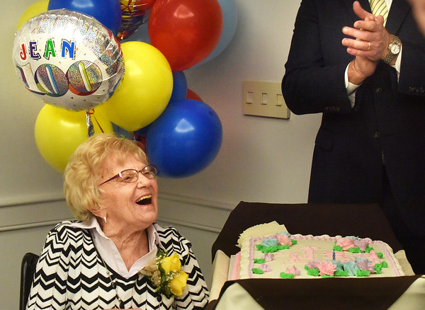 BRYAN EATON/Staff Photo. Jean Tyler is applauded as she's presented a cake at her birthday party as she turns 100 years old at Atria Merrimack Place attended by family, friends and Sen. Diana DiZoglio, Rep. James Kelcourse and Mayor Donna Holaday's office. She was born in Cincinnati,, Ohio later moving to Columbus. The mother of two, she was a preschool teacher and a volunteer at a school for the blind moving to Newburyport six years ago.