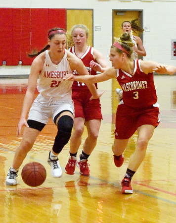 BRYAN EATON/Staff photo. Masconomet guard Makayla Graves defends against Amesbury's Alli Napoli who went on to score her 1,000th point.