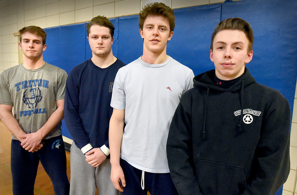 BRYAN EATON/Staff Photo. Triton High School wrestling team members, from left, Ethan Trembly, Sam Orender, Anthony Ostrander and Dylan Karpenko.