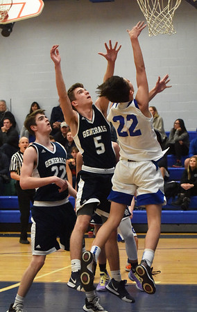 BRYAN EATON/Staff photo. Georgetown's JT Murphy tries for two as Ryan Monahan, left, and Ethan Dwyer cover.