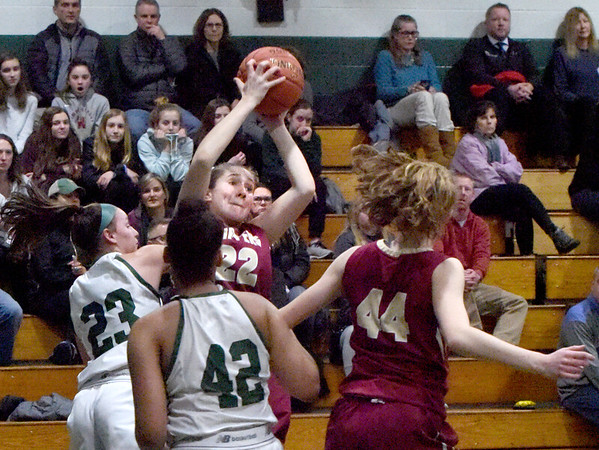 BRYAN EATON/Staff photo. The Clippers' Sadie Vandenberg grabs the rebound from Pentucket players.