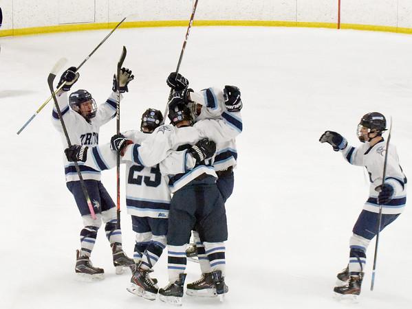 BRYAN EATON/Staff photo. Triton celebrates their first goal of the game with Wilmington.