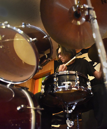 BRYAN EATON/Staff photo. For almost two years the People's United Methodist Church has hosted Coffee and Jazz from 10:00 to noon on Fridays. The musicians change from time to time in the informal setting with the public and musician welcome. The sessions are free but donations are accepted for the coffee and refreshmants served. Drummer Tristan DeWitt keeps the beat going on the small stage.