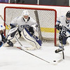 BRYAN EATON/Staff photo. Connor Kohan assists Triton goalie Wesley Rollins from an advancing Wilmington player.