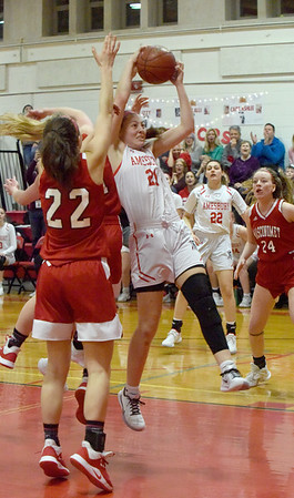 BRYAN EATON/Staff photo. Amesbury's Alli Napoli throws up the ball for her 1,000th point in a game with Masconomet.