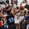 BRYAN EATON/Staff photo. Trevor Ward lays up a shot as Dracut covers.