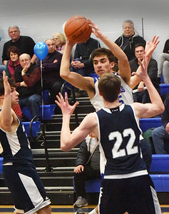 BRYAN EATON/Staff photo. Georgetown's Jack Lucido looks for an open teammate.