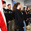 BRYAN EATON/Staff Photo. Amesbury High School a capella group, The Rhythmics, performed the Star Spangled Banner and led the Pledge of Allegiance.