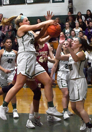 BRYAN EATON/Staff photo. Pentucket's Angelica Hurley gets the rebound on the Newburyport side.