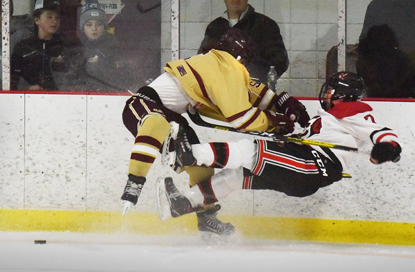 BRYAN EATON/Staff photo. Max Puleo gets time in the penalty box for this hit on Winchester's Joey Falso.